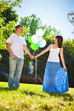 Adorable young couple holding bunch of balloons royalty free stock photography