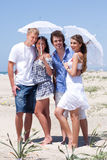 Adorable young couples under an umbrella Royalty Free Stock Photo