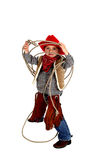 Adorable young cowboy wearing chaps, boots, and ha. An Adorable young cowboy playing with a rope royalty free stock photos