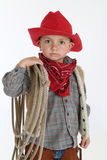 Adorable young cowboy wearing a red hat and holdin Stock Image