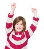 Adorable young girl with arms raised in success. Close up portrait of an adorable young girl with arms raised in success on isolated white background royalty free stock images