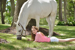 Adorable young girl with her horse Royalty Free Stock Photos