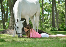 Adorable young girl with her horse Royalty Free Stock Photo