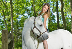 Adorable young girl with her horse Stock Photography