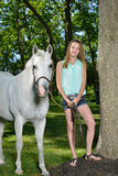 Adorable young girl with her horse Stock Photos