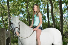 Adorable young girl with her horse Stock Image