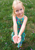 Adorable young girl holding grasshopper Royalty Free Stock Image