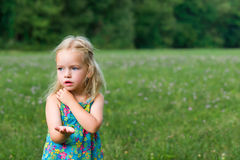 Adorable young girl holding grasshopper Stock Photography