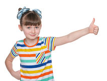 Adorable young girl holds her thumbs up Stock Photos