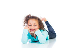 Adorable young girl laying down Royalty Free Stock Photos