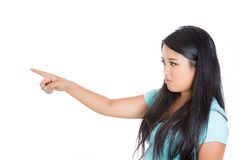 An adorable young girl pointing at someone or something in anger Stock Image