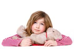 Adorable young girl relaxing with teddy bear Stock Images