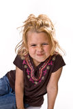 Adorable young girl scrunching her nose Stock Photo
