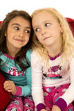 Adorable young girls portrait looking at each other Stock Photos