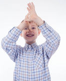 Adorable young grimace boy Royalty Free Stock Photo
