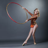 Adorable young gymnast performing with hoop Royalty Free Stock Photo