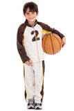 Adorable young kid in his sports dress with ball Royalty Free Stock Image