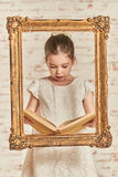 Adorable young little girl reading a book Royalty Free Stock Image