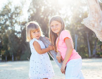 Adorable young sisters at the beach Royalty Free Stock Photography