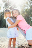 Adorable young sisters at the beach Stock Photos