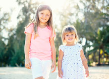 Adorable young sisters at the beach Royalty Free Stock Photo