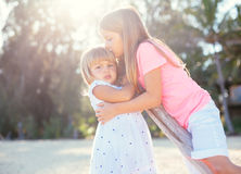Adorable young sisters at the beach Royalty Free Stock Images