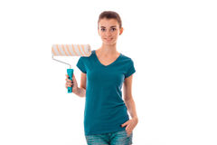 Adorable young slim builder girl makes renovations isolated on white background Stock Photos