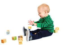 Adorable young toddler boy playing with toy blocks Royalty Free Stock Photo