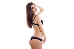 Adorable young woman with beautiful round ass in black underwear looking at the camera Royalty Free Stock Photography