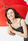 Adorable young woman in dress with open umbrella Stock Photo