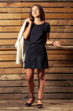 Adorable young woman in photo shoting on wooden background Stock Image