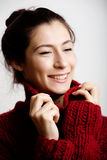 Adorable young woman in sweater at home smiling Royalty Free Stock Photo