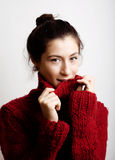 Adorable young woman in sweater at home smiling Royalty Free Stock Image