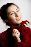 Adorable young woman in sweater at home smiling Royalty Free Stock Images