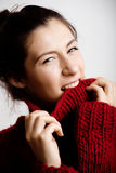 Adorable young woman in sweater at home smiling Stock Photos