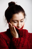 Adorable young woman in sweater at home smiling Stock Images
