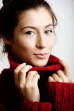 Adorable young woman in sweater at home smiling Royalty Free Stock Photos
