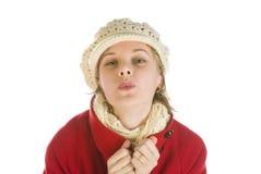 Adorable young woman in a winter cap kissing Stock Photos