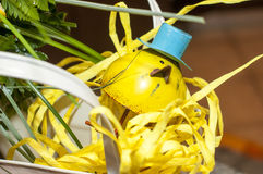 Small yellow bird ornament with top hat Stock Photos