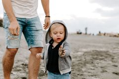 Adorably Perfect Young Father and Baby Toddler Son Family Having Fun Time at the Sandy Beach During Sunset Outside By the Ocean Wa. Ter on Travel Vacation stock photos