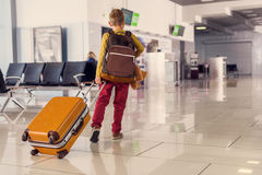 Adoralbe little boy at airport royalty free stock photography