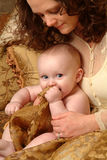Adoration. Mother looking adoringly at her beautiful child Stock Photography