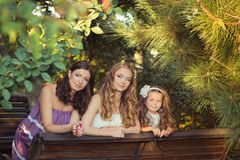 Adoring Brunette blond chestnut blue eyes sisters girls wearing cosy night white purple dress enjoying lifetime together summer su. Nny day in garden forest Stock Photos