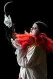 Adoring the moon. Beautiful Pierrot clown playing mime with the moon Stock Photos