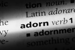 Adorn. Word in a dictionary.  concept royalty free stock images