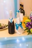 Adornado casandose la botella de champán Fotografía de archivo