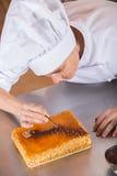 Adornamiento del chef de repostería Foto de archivo