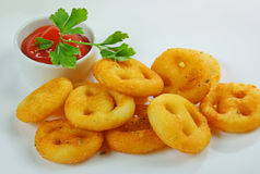 Adorne con las patatas fritas Foto de archivo libre de regalías