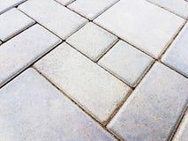 Adorne de fondo concreto de la calzada del ladrillo cuadrado Imagenes de archivo