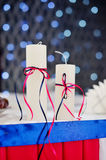 Adorned decor with two candles on the background bokeh Royalty Free Stock Photography